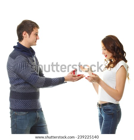 marriage proposal, man give ring to his girl, young happy couple romantic date, celebrating valentine day. - stock photo
