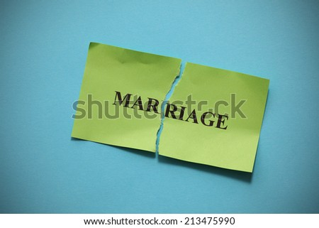 """Marriage Rift (broken marriage).Torn of paper with the word """"Marriage"""". Concept Image. - stock photo"""
