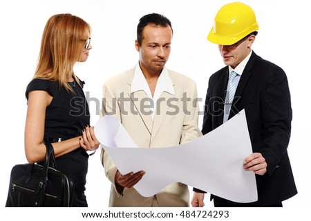 Married couple and architect looking to the blueprint and discussing about the house construction plan. Studio shot, over white background