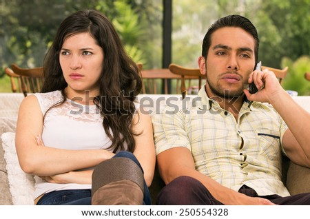 married couple fighting having an argument at home - stock photo