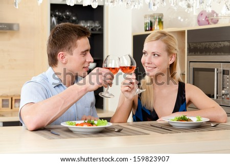 Married couple has romantic dinner in the kitchen