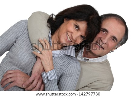 Married couple hugging - stock photo
