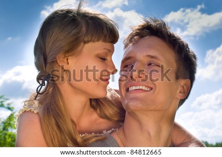 married couple (in love) on a nature background - stock photo