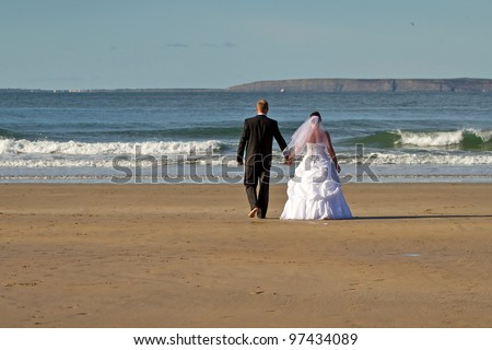 Married couple on the beach