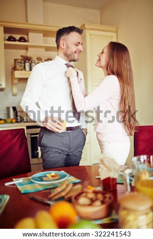 Married couple standing by table in the kitchen
