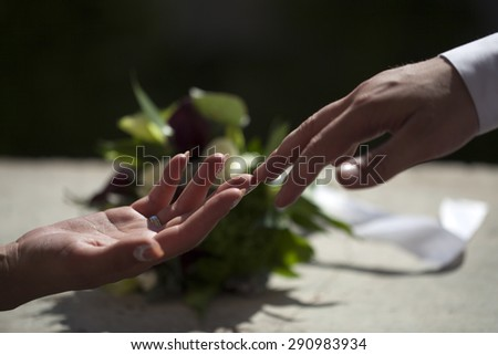 Married couple touching each other with hands on celebration background closeup, horizontal picture - stock photo