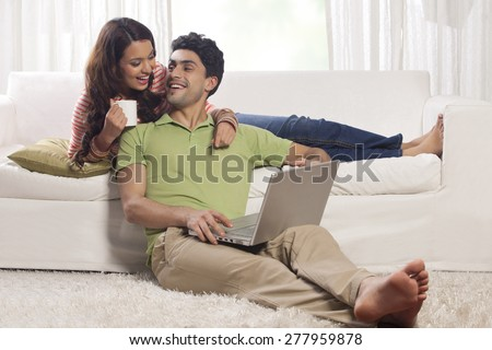 Married couple with a laptop - stock photo