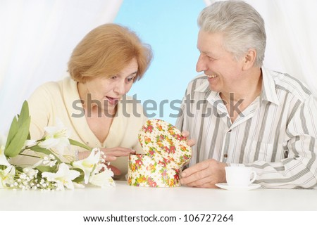 Married elderly couple resting at home and enjoying each other's company