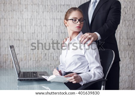 Married man boss seducing young secretary in office - stock photo
