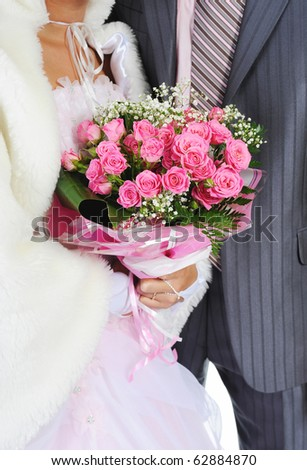Married with a bouquet of pink roses