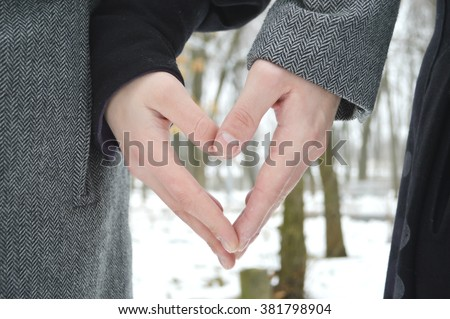 Married young loving couple holding hands each other in park, face is not visible.Couple holding hands and walking in park.hands holding together, concept of love, family, dating