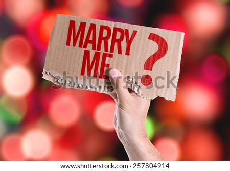 Marry Me? card with colorful background with defocused lights - stock photo