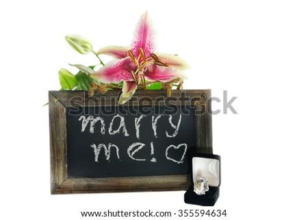 Marry me note written on the chalkboard - stock photo