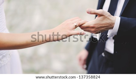 marry me today and everyday, hands of a wedding heterosexual couple - stock photo