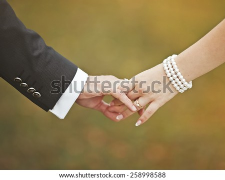 Marry me today and everyday. Newlywed couple holding hands, wedding picture.