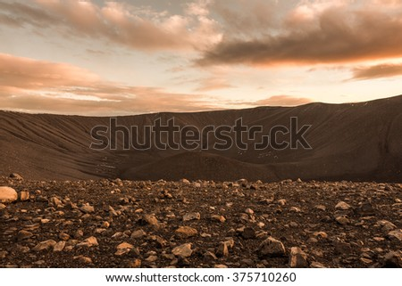 Mars surface landscape with explorers in distance - stock photo