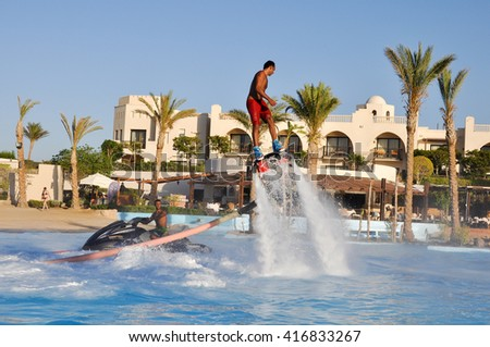 Marsa ALAM - EGYPT,JULY 21,2014:a Man is flying on a flyboard in the pool in Marsa Alam