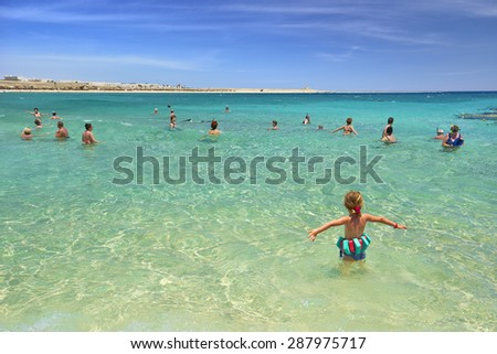 MARSA ALAM, RED SEA, EGYPT - MAY 05: Unidentified people swim in shallow bay on May 05, 2015 Marsa Alam, Egypt. Marsa Alam is a popular resort i located in the south-eastern part of Egypt.