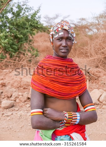 Marsabit, Kenya - March 3, 2015: Tribal woman in traditional dress. Picture was taken near Marsabit in Kenya on the road to Laisamis