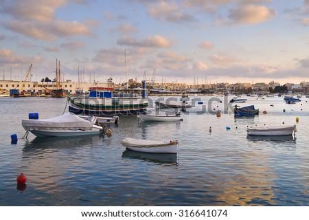 Marsamxett Harbour at dusk with boats berthed. Sliema near La Valletta in Malta, Europe - stock photo