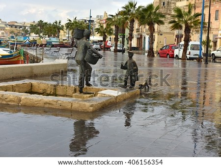 MARSAXLOKK, MALTA - dec 10: the ancient fishing village Marsaxlokk in Mediterranean sea on rainy winter day on dec 10, 2015. Street view of Marsaxlokk village