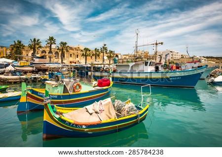 Marsaxlokk, Malta - 24 May 2015: fishing boats near fishing village of Marsaxlokk (Marsascala) in Malta - stock photo