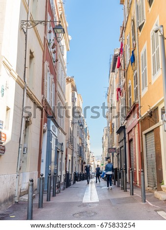 MARSEILLE - APRIL 11 : Narrow walking road with old buildings in Marseille, France, on April 11, 2017.