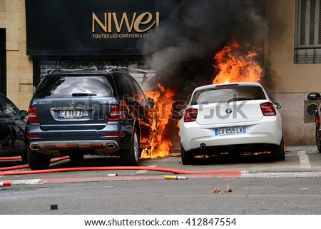 Marseille, France - April 28, 2016 : Cars on fire during clashes between protesters and french riot police during a demonstration against the labor law - stock photo