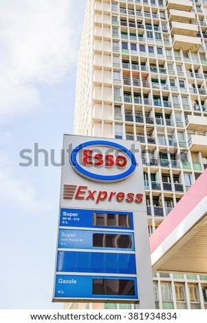 MARSEILLE, FRANCE - JUL 18, 2014: Esso Express petrol fuel station with large appartment building behind. Esso is an American brand that is the American trade name for ExxonMobil