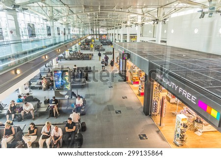 MARSEILLE, FRANCE - JULY 7, 2015: people in the terminal of Marseille Airport in Marseille, France. It is the fifth busiest French airport by passenger traffic and third largest for cargo traffic - stock photo