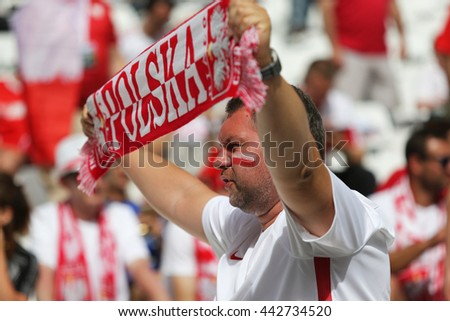 MARSEILLE, FRANCE - JUNE 21, 2016: Polish fan shows his support during the UEFA EURO 2016 game Ukraine v Poland at Stade Velodrome in Marseille. Poland won 1-0 - stock photo