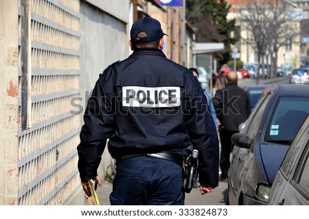 Marseille, France - March 12, 2015 : French policeman walking down the street.