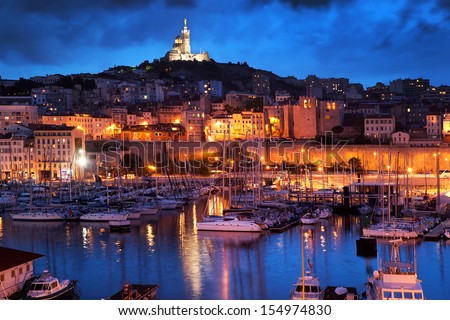 Marseille, France panorama at night. The famous european harbour view on the Notre Dame de la Garde - stock photo