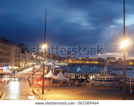 MARSEILLE-SEPT. 17: The port and harbor of Marseille, France is seen at night with yachts, tour boats and hotels lit by street lights on Sept. 17, 2015.      - stock photo