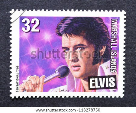 MARSHALL ISLANDS- CIRCA 1997: A postage stamp printed in Marshall Islands showing an image of Elvis Presley, circa 1997. - stock photo
