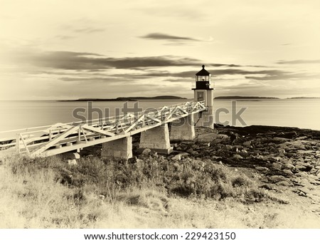 Marshall Point Lighthouse in a vintage style at sunset - stock photo