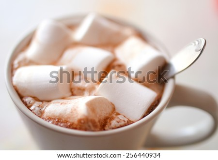 Marshmallow in a coffee cup. - stock photo