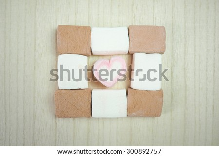 Marshmallow. Love sign. Pale tone.