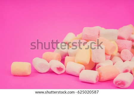 Marshmallow on a pink background. Pattern with marshmallow. Selective focus, Vintage style.