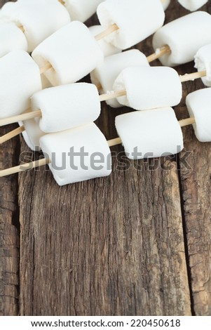 marshmallow ready to be cooked on bbq - stock photo