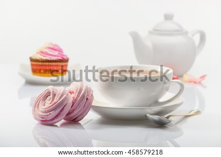 marshmallows and cup of tea - stock photo