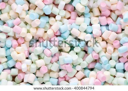 Marshmallows. Background or texture of colorful mini marshmallows. - stock photo
