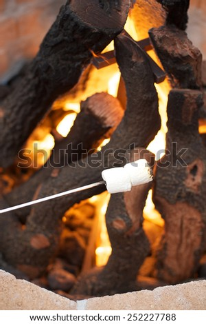 Marshmallows cooking over hot fire - stock photo