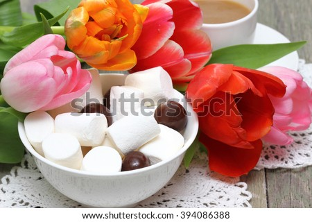 Marshmallows with tulips - stock photo