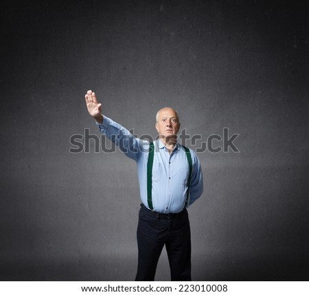 martial and nostalgic military saluting - stock photo