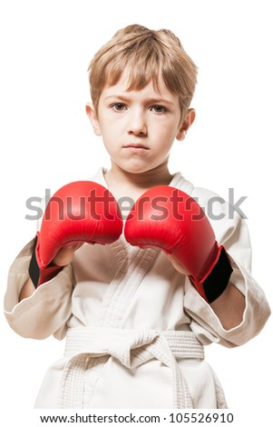 Martial art sport - child boy in white kimono training karate punch - stock photo