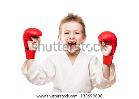 Martial art sport - smiling karate champion child boy gesturing for victory triumph - stock photo