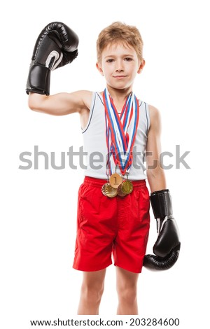 Martial art sport success and win concept - smiling boxing champion child boy holding first place victory gold medal award - stock photo