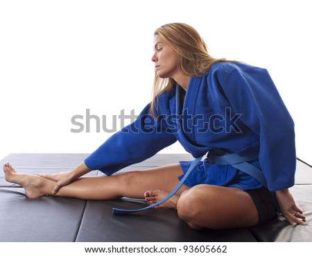 Martial artist stretching and warming up  - stock photo