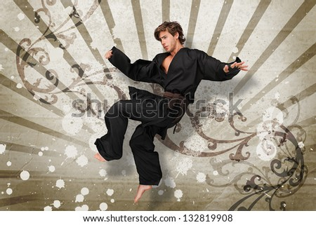 Martial arts expert jumping on beige art nouveau style design - stock photo